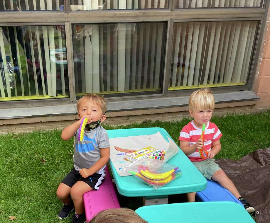 Children at B'nai Torah Nursery School blow shofars (pretend rams' horns) for Rosh Hashanah, the Jewish New Year, which began Friday, Sept. 18 at sundown. Apples and challah are dipped in honey for a sweet new year. Photo: Contributed Photos /