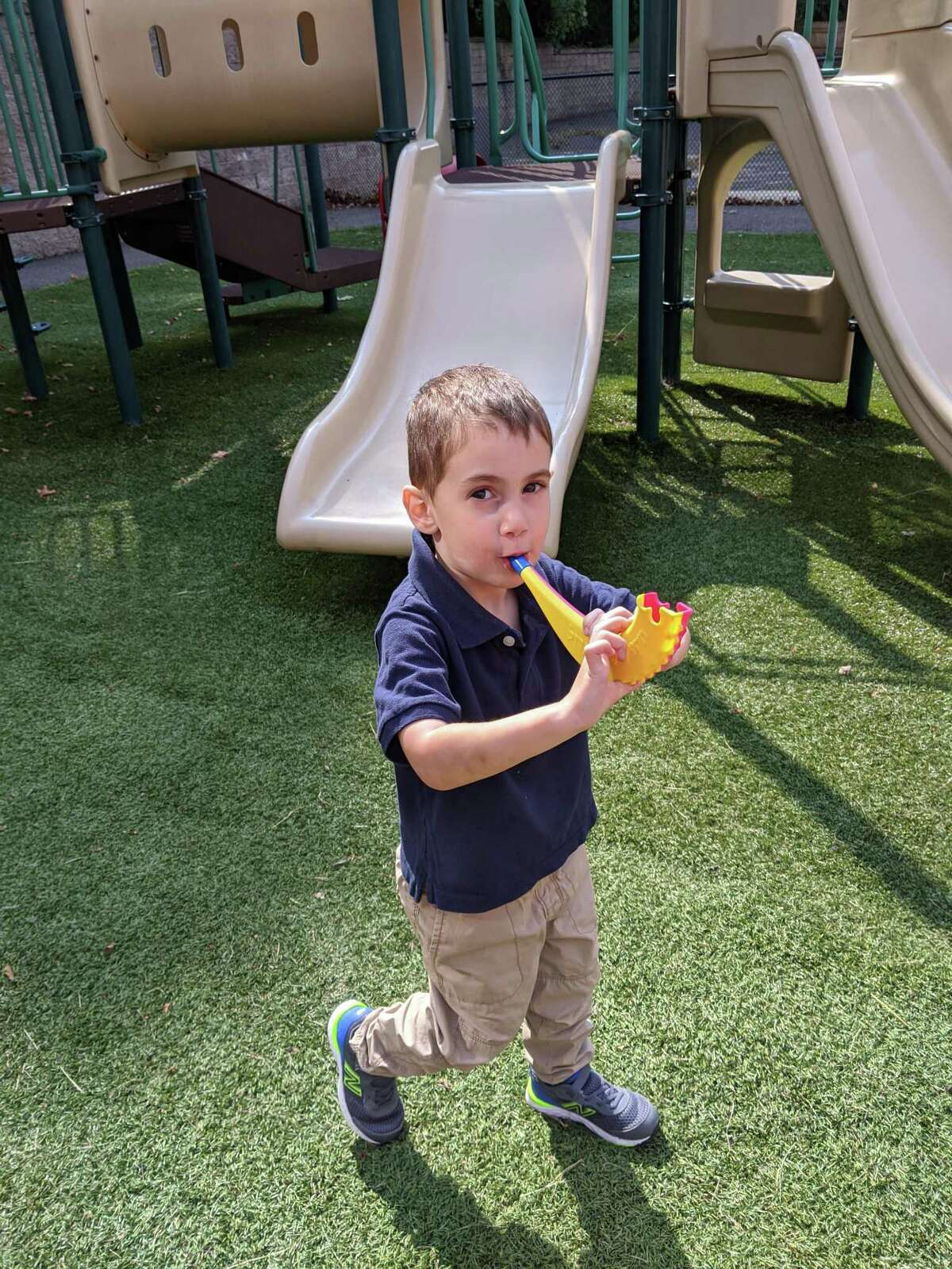 Children at B'nai Torah Nursery School blow shofars (pretend rams' horns) for Rosh Hashanah, the Jewish New Year, which began Friday, Sept. 18 at sundown. Apples and challah are dipped in honey for a sweet new year.