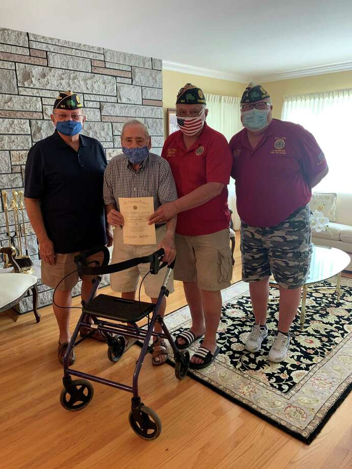 Anthony Salce was awarded a certificate for 80 years of continuous membership in the American Legion, which celebrated its 100th anniversary on June 10, 2019. At the same ceremony, Salce was given a seated walker. Anthony will turn 99 in January. He served in the United States Coast Guard during WWII and was at Normandy on D Day and is a member of American Legion Post 141 in Trumbull. Pictured are Senior-Vice Commander Joseph Montanaro, Commander Ernie Foito and District 3 Adjutant Tom Moore along with Salce. Photo: Contributed Photo /
