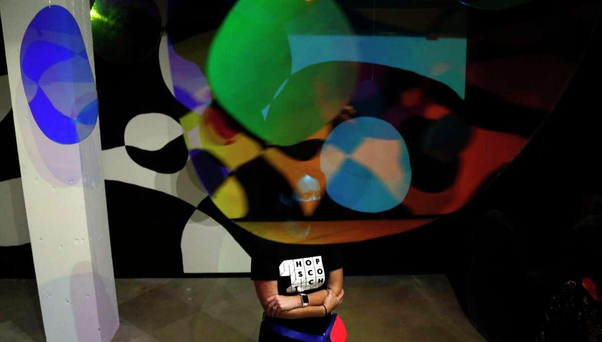 Nicole Jensen stands in Amada Millers immersive sculpture