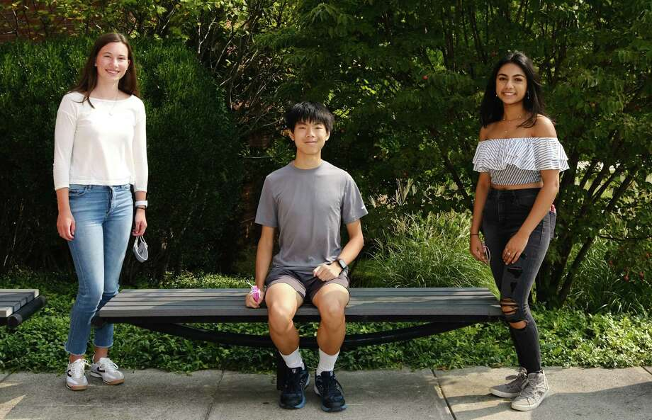 Darien High School National Merit Scholar finalists include Natalie Volz, left, Nicholas Liu, and Veda Malhotra. Photo: Darien High School