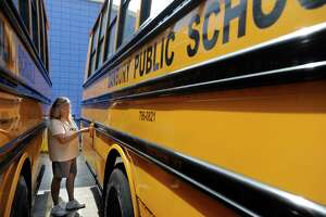 Roxanne Pagniello, 53, of Danbury, goes through a pre-trip check list, before making a practice run of her bus route Friday, Aug. 24, 2012. Pagniello is starting her second year as a school bus driver for Student Transportation of America in Danbury. She'll be driving Danbury High School kids as well as students from two elementary schools.