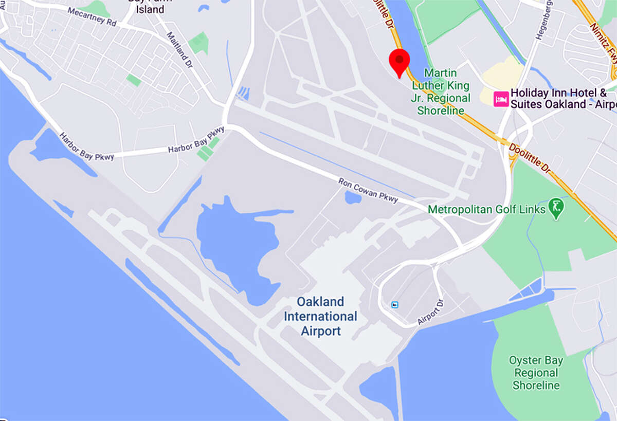 The COVID-19 testing facility at Oakland (red pin) will be across the airport from the passenger terminals.