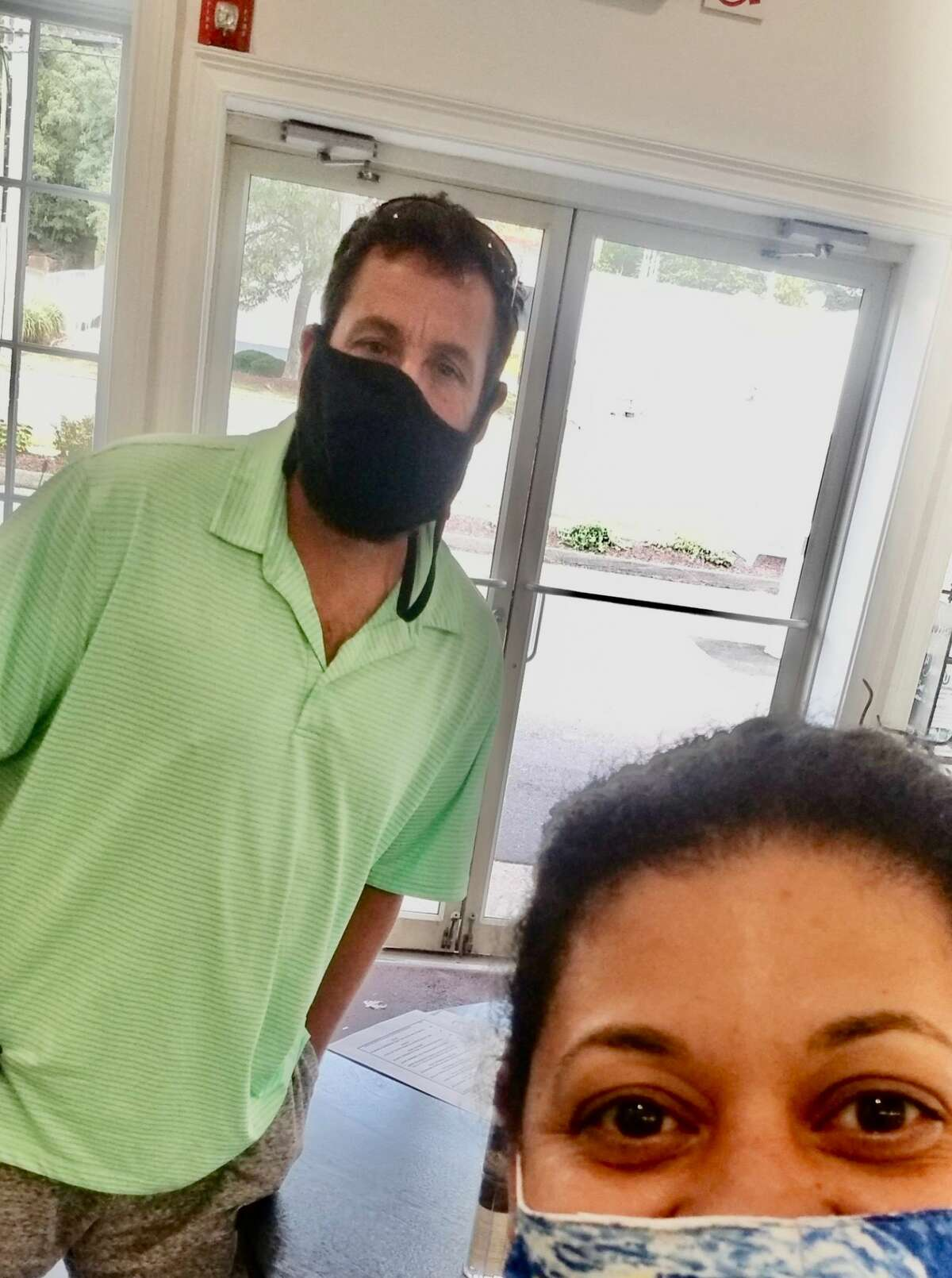Adam Sandler and Marisol Ballejo at Fred 06825 in Fairfield to pick up food on Sept. 28, 2020. Sandler was passing through with his parents on his way to Philadelphia and arrived at the deli around 2 p.m. to pick up food with which he planned to break his Yom Kippur fast, according to owner Fred Kaskowitz. He entered alone wearing a black mask and ordered turkey meatballs, sweet and sour peppers and panko-crusted chicken; Kaskowitz said they threw in a free brownie for