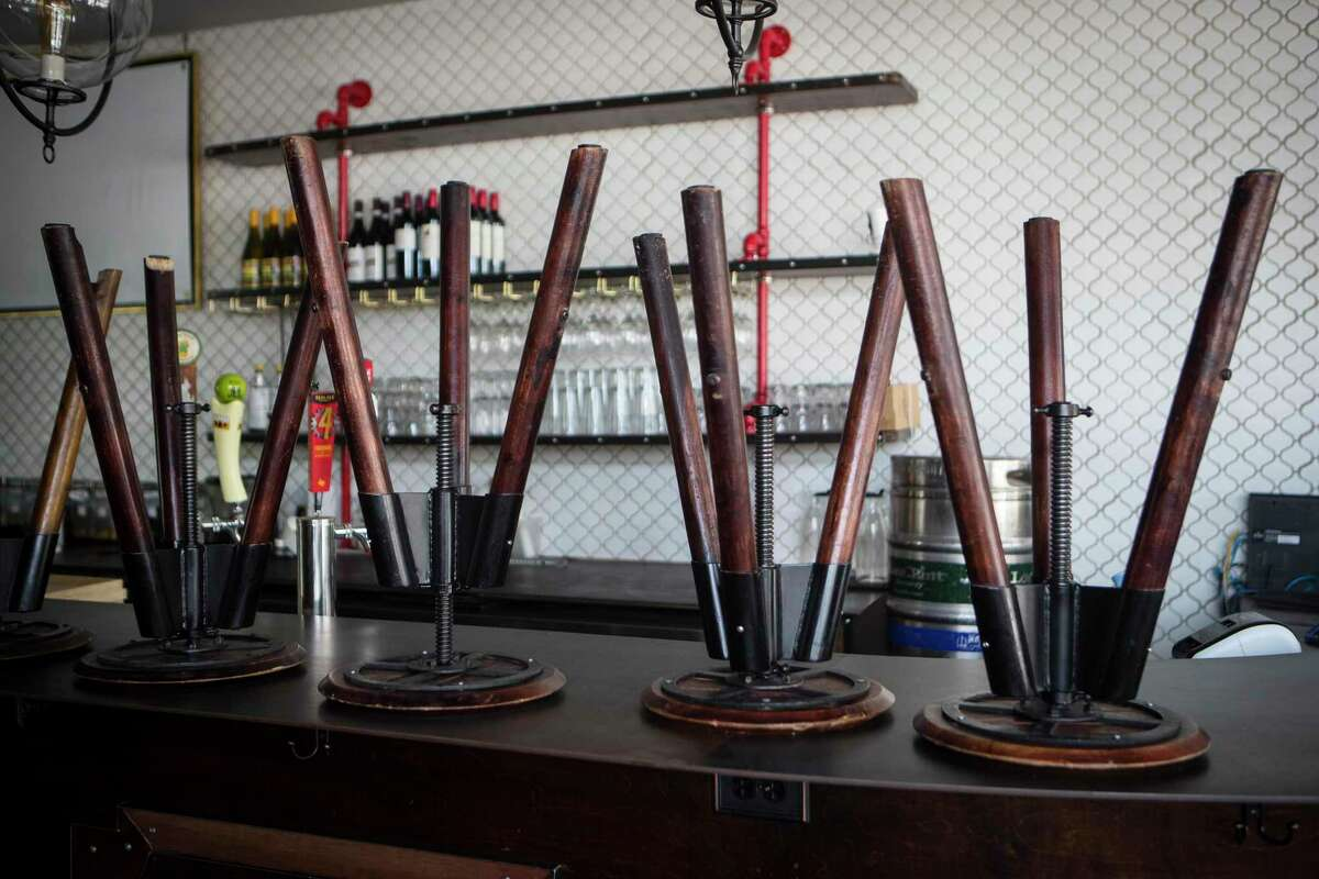 Stools are stacked up on the bar at Cafeza as the coffee shop and live music venue is mostly selling coffee and food to-go.