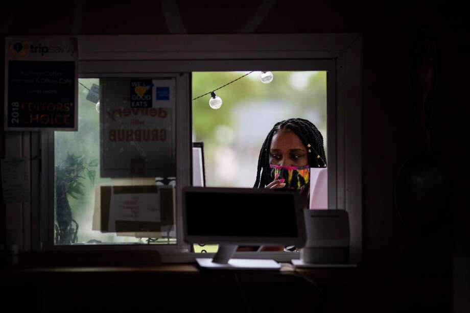 A service window that was installed in January became very useful during the pandemic. Photo: Marie D. De Jesús, Houston Chronicle / Staff Photographer / © 2020 Houston Chronicle
