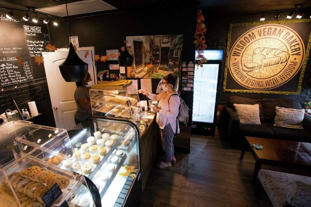 Oricha Plavsic serves a customer at Wisdom Vegan Bakery.
