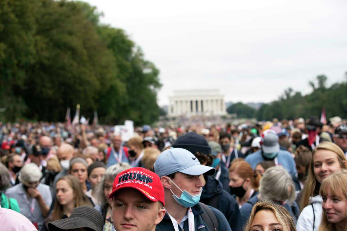 Followers of Franklin Graham march from the Lincoln Memorial to Capitol Hill, during the Prayer March at the National Mall, in Washington, Saturday, Sept. 26, 2020. (AP Photo/Jose Luis Magana)
