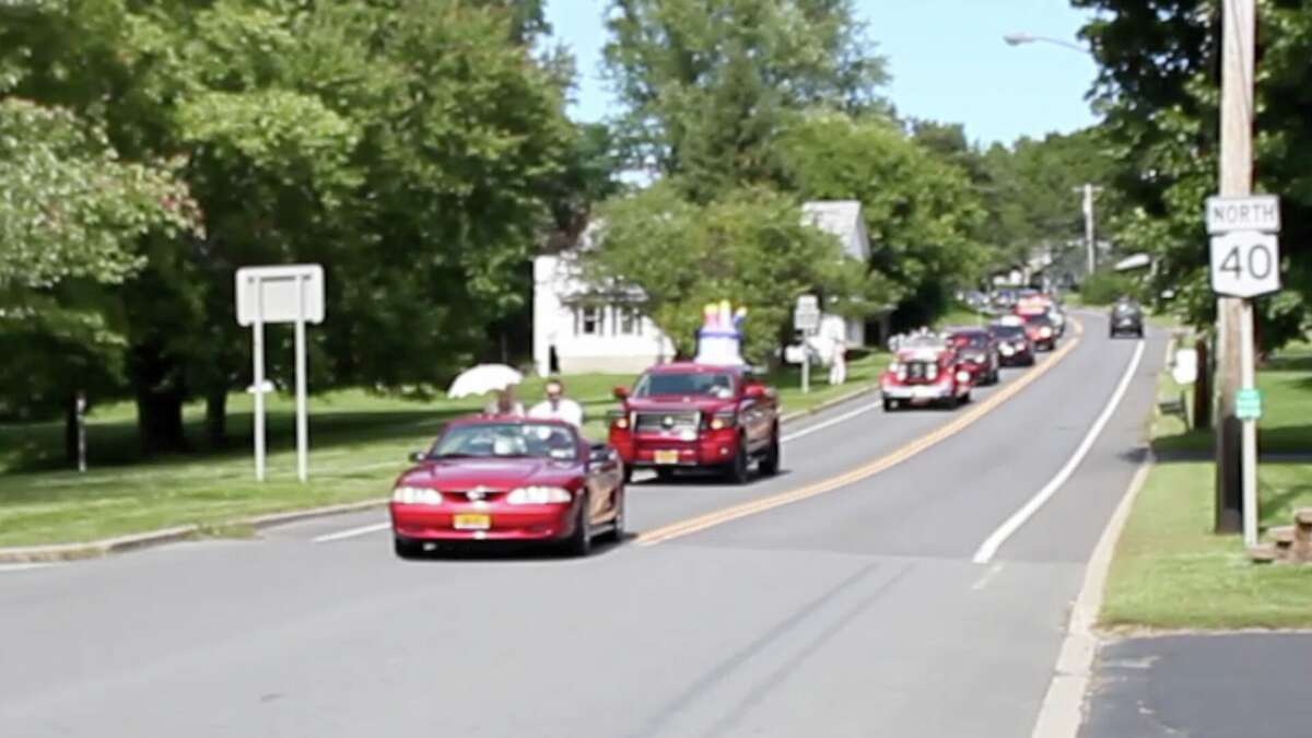 On Saturday, September 12th, a parade was held in Speigletown, NY, celebrating Carolyn Coleman's 90th birthday. The parade traveled down Route 40 escorted by Speigletown Fire Department. It then pulled into Carolyn's backyard where the celebrating continued with a chorus of Happy Birthday and cookies and photos handed to each guest. Photo by Brandon Macey