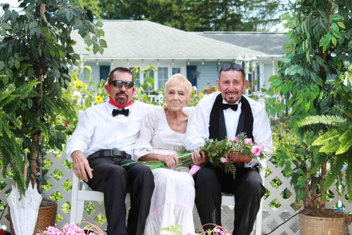Carolyn (center) along with her sons Warren (left) and Steve (right)