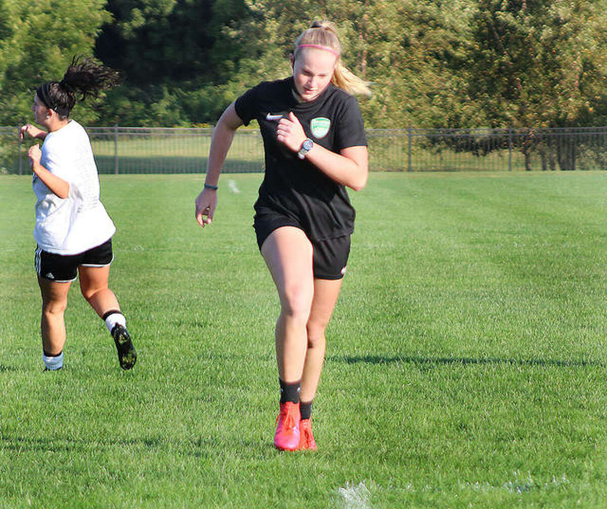 Lewis and Clark Community College sophomore Candice Parziani grits out a sprint drill during a team workout last week at Tim Rooney Stadium in Godfrey. Parziani, an NJCAA All-American last season, missed last year's LCCC trip to the NJCAA National Tournament because of illness. The NJCAA postponed soccer from fall to next spring because of COVID-19, meaning by the time Parziani takes the field again, it will have been nearly 18 months between games for her.