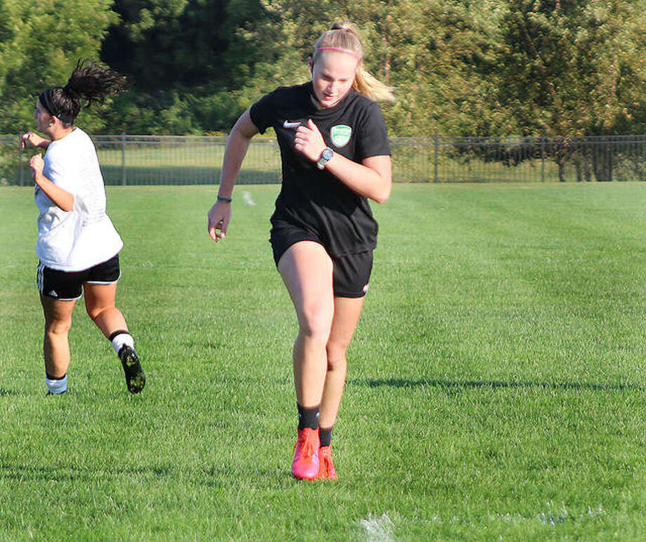 Lewis and Clark Community College sophomore Candice Parziani grits out a sprint drill during a team workout last week at Tim Rooney Stadium in Godfrey. Parziani, an NJCAA All-American last season, missed last year's LCCC trip to the NJCAA National Tournament because of illness. The NJCAA postponed soccer from fall to next spring because of COVID-19, meaning by the time Parziani takes the field again, it will have been nearly 18 months between games for her. Photo: Pete Hayes | The Telegraph