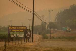 A welcome sign to Napa Valley is seen in the air filled with smoke from the Glass Fire in St. Helena, Calif., on Sept. 28, 2020.
