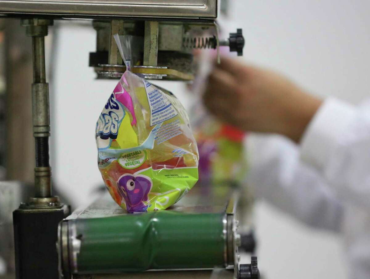 Reina Meals's Kiddie Gels jelly dessert is packaged into bags at the company's new food plant and warehouse on Friday, July 20, 2018, in Houston. Reina Meals was H-E-B's Quest for Best finalist in 2016 and some of their products are exclusively carried at H-E-B. ( Yi-Chin Lee / Houston Chronicle )