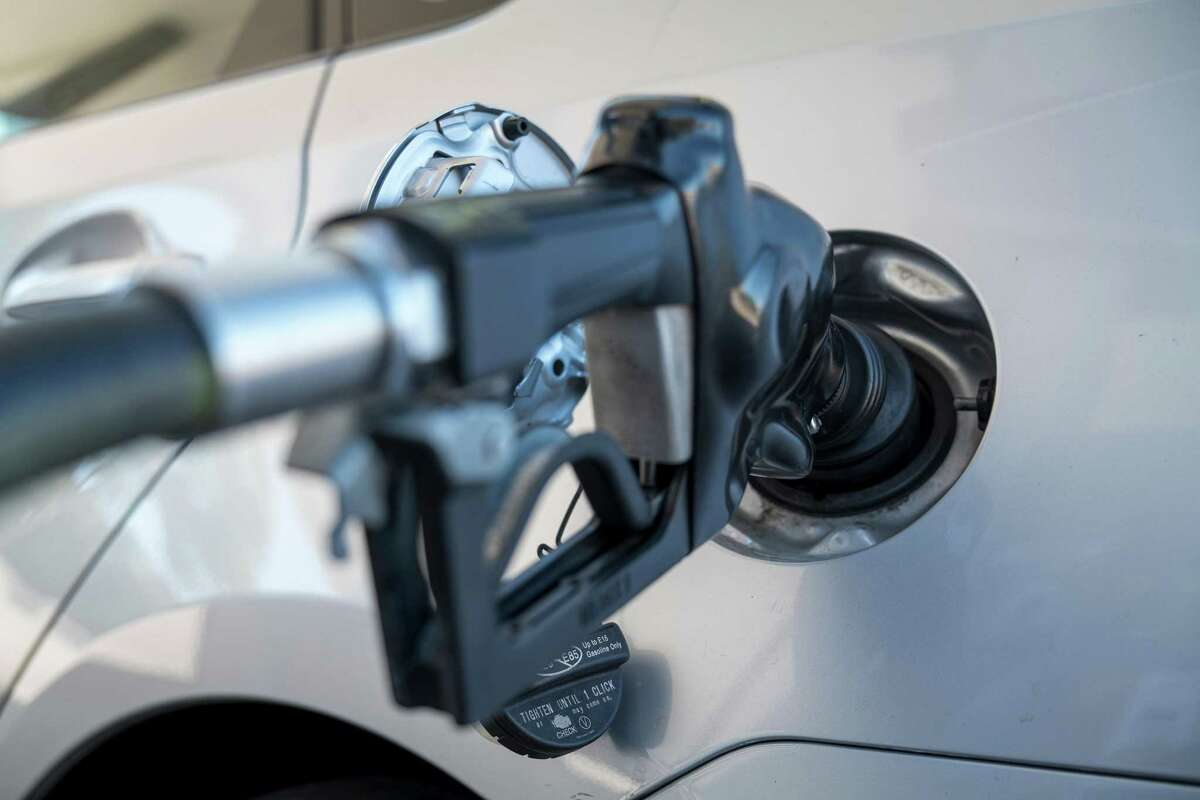A fuel pump nozzle in a vehicle gas tank in Pinole, California, U.S., on Thursday, Sept. 24, 2020. California will phase out sales of new, gasoline-powered cars by 2035 as part of its fight against climate change, Governor Gavin Newsom announced -- the first state to set an expiration date for the traditional automobile.