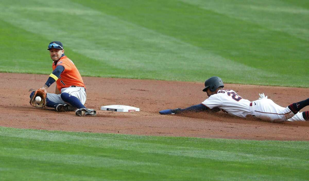 Houston Astros shortstop Carlos Correa (1) tries to tag Minnesota Twins Byron Buxton as he stole second base during the first inning of an MLB Wild Card game at Target Field, Tuesday, September 29, 2020, in Minneapolis.