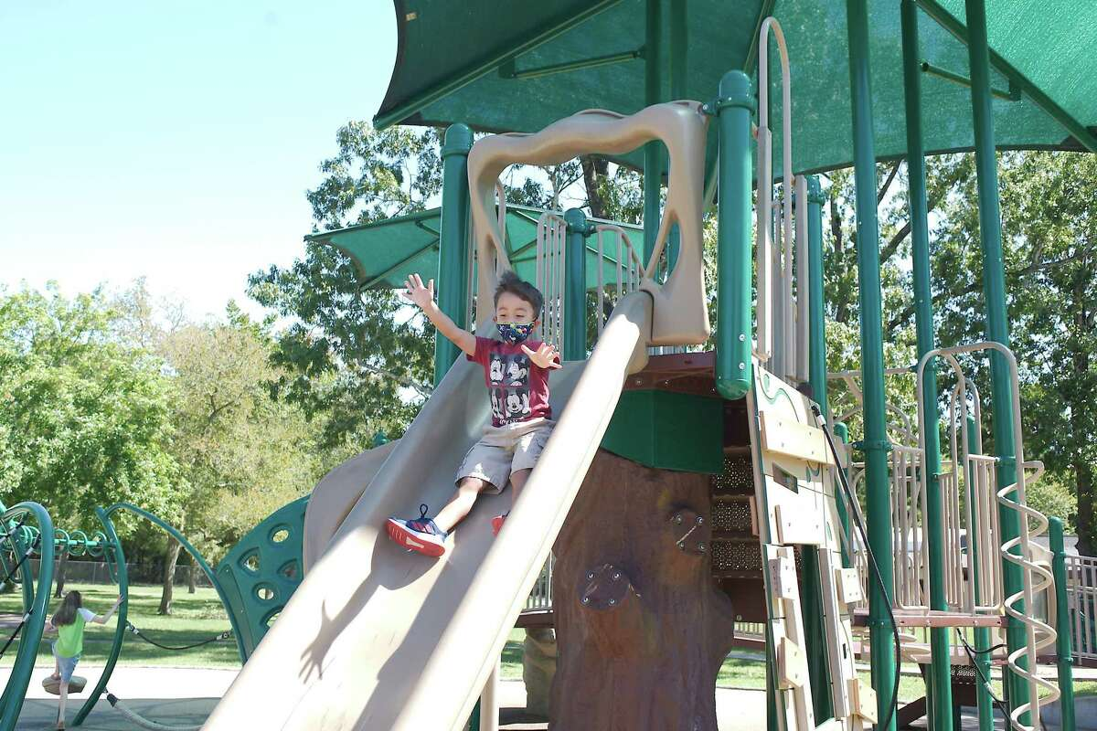 Troy Braden enjoys the slide at Bay Area Park. Harris County Precinct 2 has reopened facilities at its parks two months after a COVID-19 spike in the county prompted an order limiting access to park amenities.