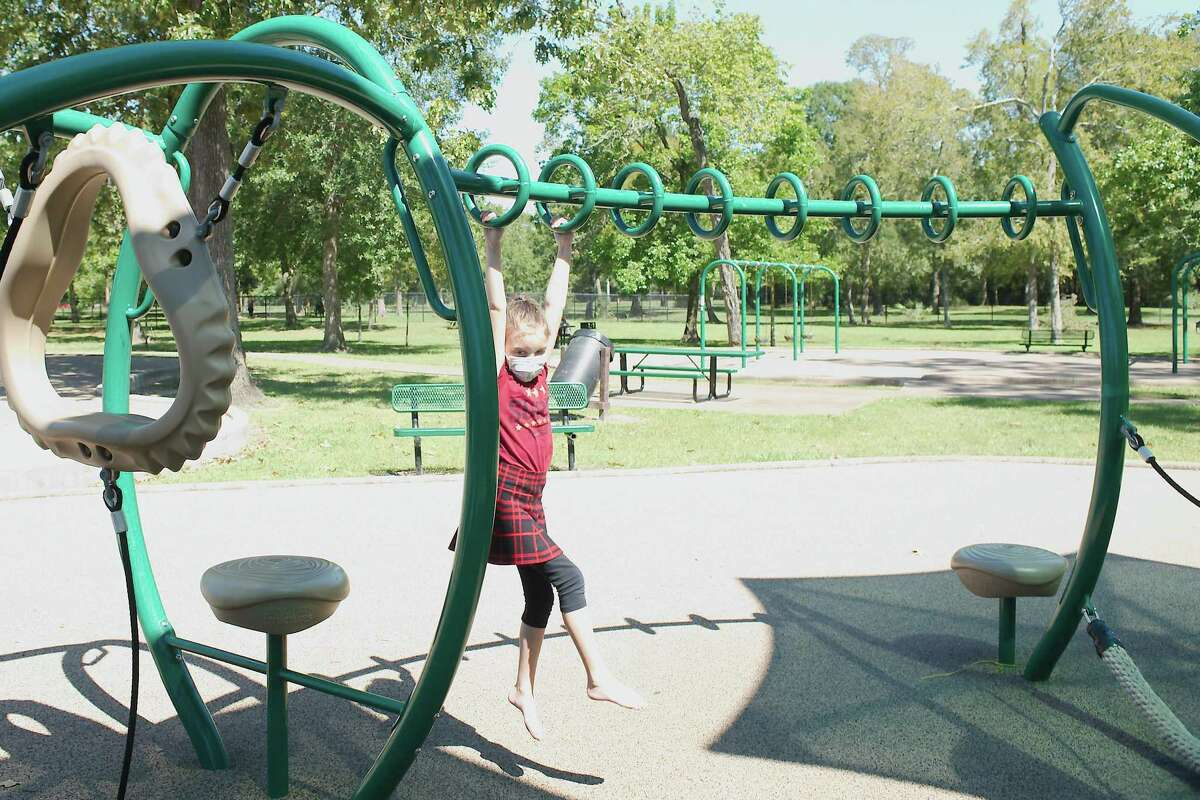 Elisi Hebert enjoys the playground structure at Bay Area Park.