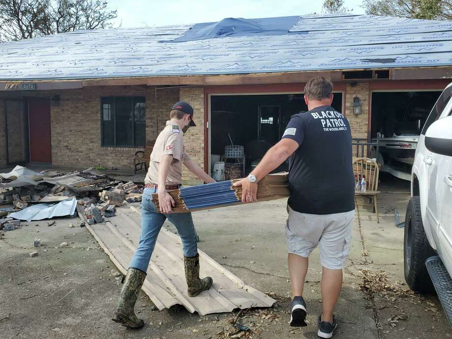 After Hurricane Laura swept through East Texas and over the border to Louisiana, local Boy Scout Troop 777 began gathering supplies for the storm's victims in Lake Charles. In a few weeks, they will return to help the victims rebuild. Rafe and his father John Kotalik help bring resources to a home in Louisiana. Photo: Provided