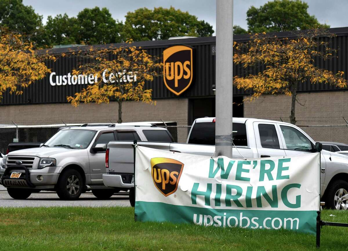 A recruitment sign is displayed outside the Latham UPS distribution center on Tuesday, Sept. 29, 2020, in Colonie, N.Y. UPS is planning to hire 690 locally in advance of the Christmas shopping season. (Will Waldron/Times Union)