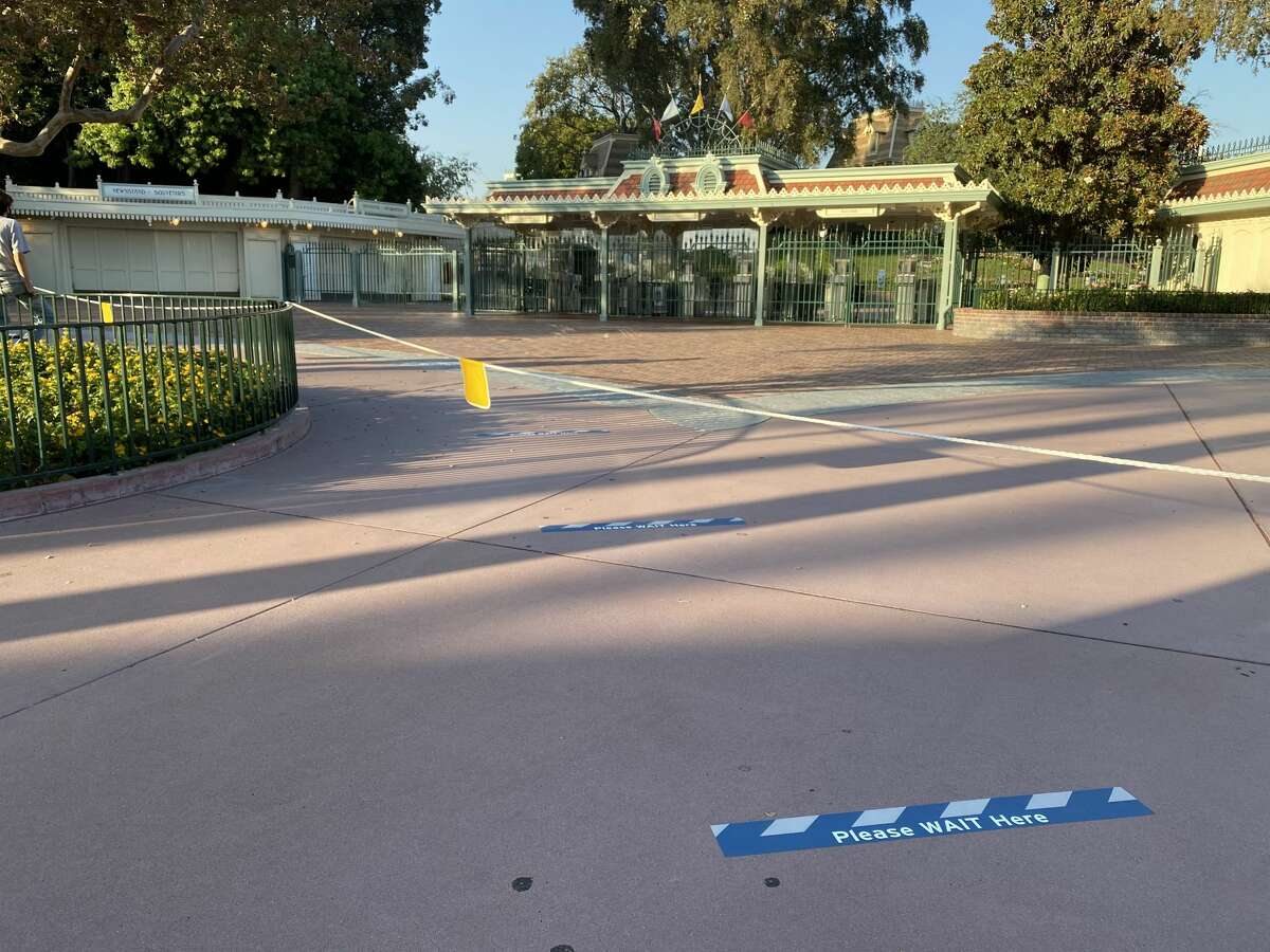 To prepare for the reopening of Disneyland, social distancing markers have been placed at the entrance of the theme park.