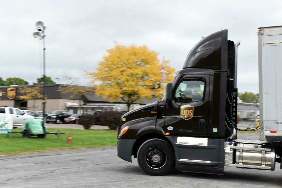 A truck rolls out of the Latham UPS distribution center on Tuesday, Sept. 29, 2020, in Colonie, N.Y. UPS is planning to hire 690 locally in advance of the Christmas shopping season. (Will Waldron/Times Union)