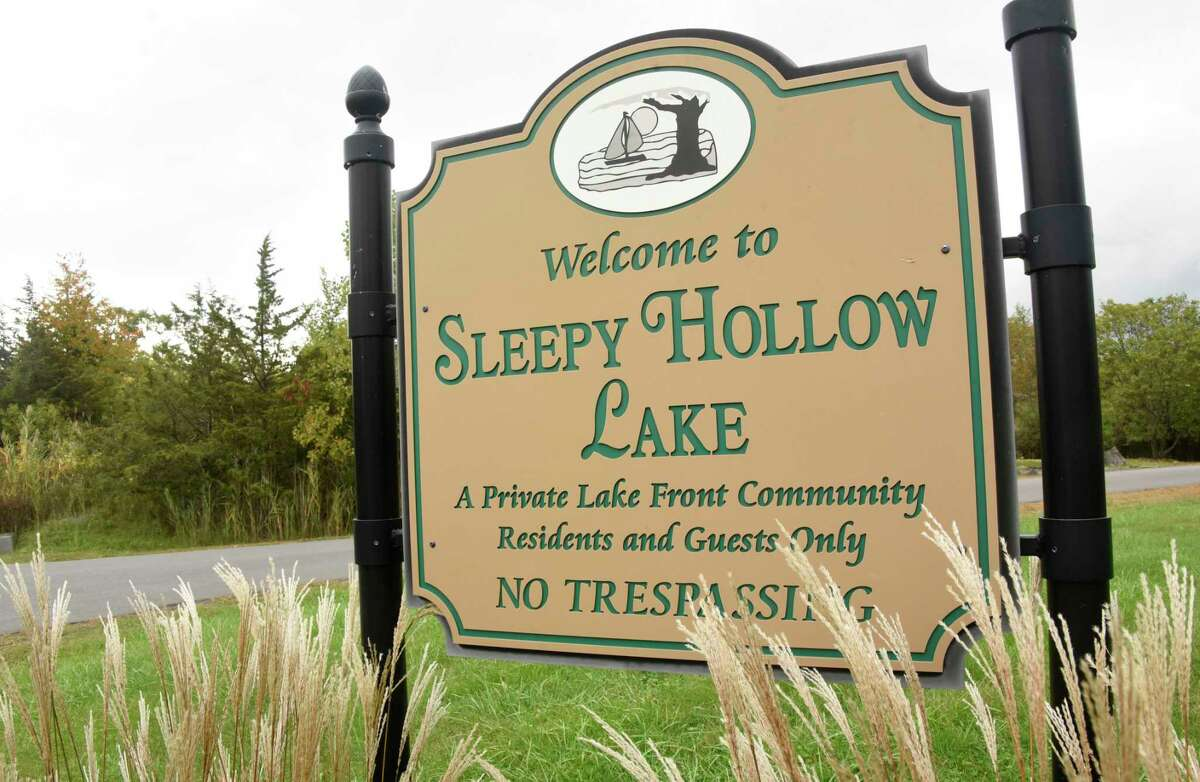 Sign for Sleepy Hollow Lake residential community is seen down the road from land where a large solar farm is planning on being built on Tuesday, Sept. 29, 2020 in Coxsackie, N.Y. (Lori Van Buren/Times Union)