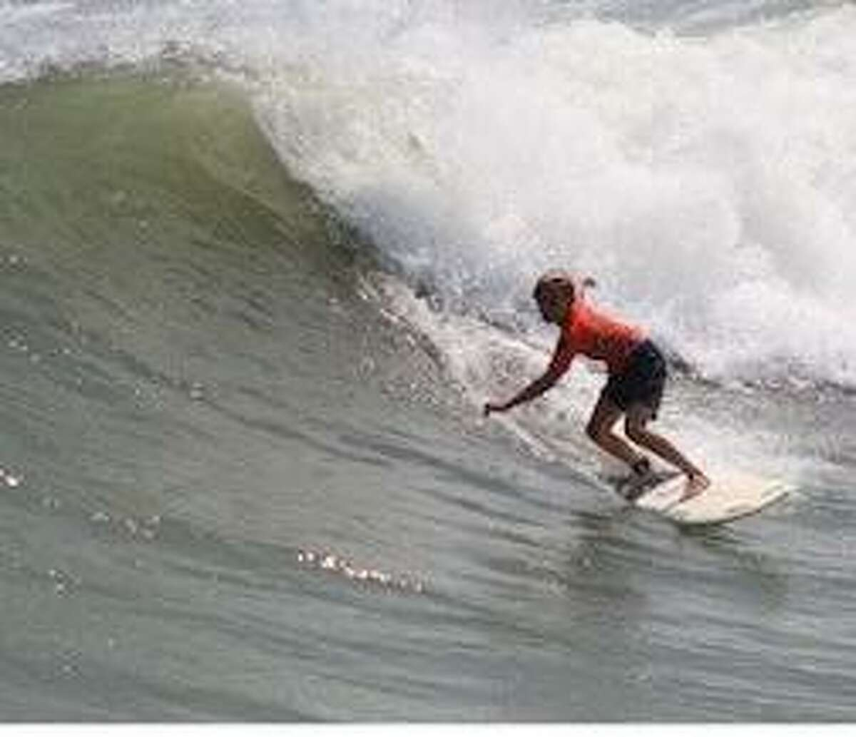 Likely riding a Tropical Storm Beta wave, Caden Shelton demonstrates to the judges his wave-riding abilities at the TGSA state championships.