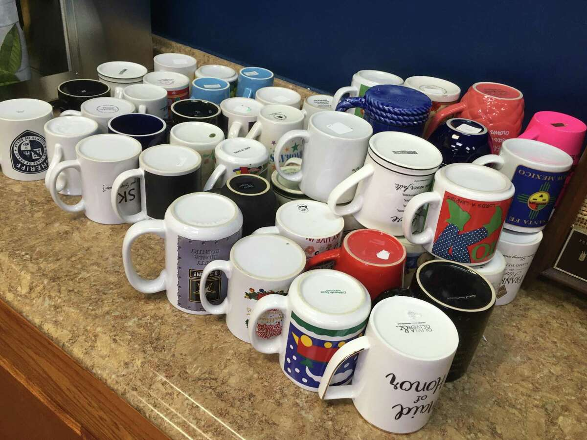 A collection of donated coffee cups are available for diners at Papa's Sartén, who can get all the coffee they can drink for $1.