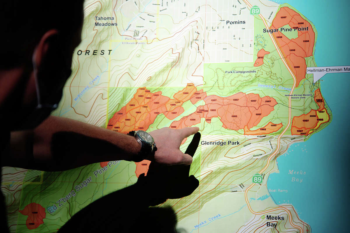 Rich Adams, a Forester II within the California State Parks system, points to plots of Ed Z'berg Sugar Pine Point State Park that have seen prescribed burns. The park's prescribed burn program started in 1984 in an effort to more closely mimic the natural fire cycles of Sierra Nevadan forests.