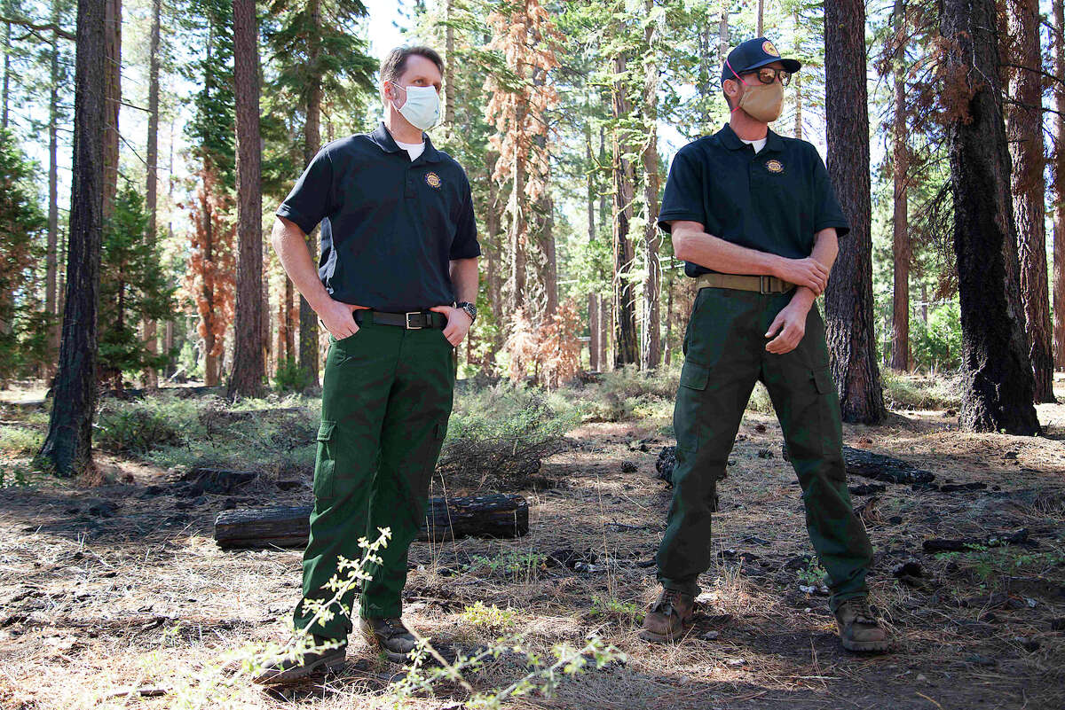 Rich Adams, left, and Dave Murray survey previous prescribed burns on various plots of Ed Z'berg Sugar Pine Point State Park on Sept. 24, 2020.