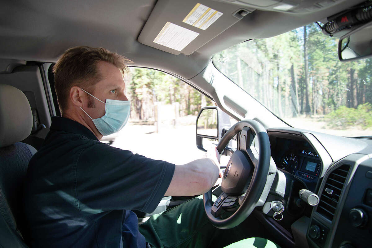 Rich Adams is a Forester II within California State Parks, often working on forest management practices such as prescribed burns. Adams surveyed the grounds of Ed Z'berg Sugar Pine Point State Park on Sept. 24, 2020.
