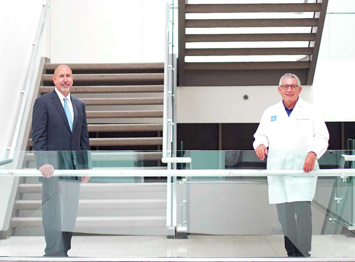 St. Luke's Health CEO Doug Lawson, left, and Dr. Paul Klotman, president of Baylor College of Medicine, reorganized its transplant surgery team and refined the criteria for patient selection.