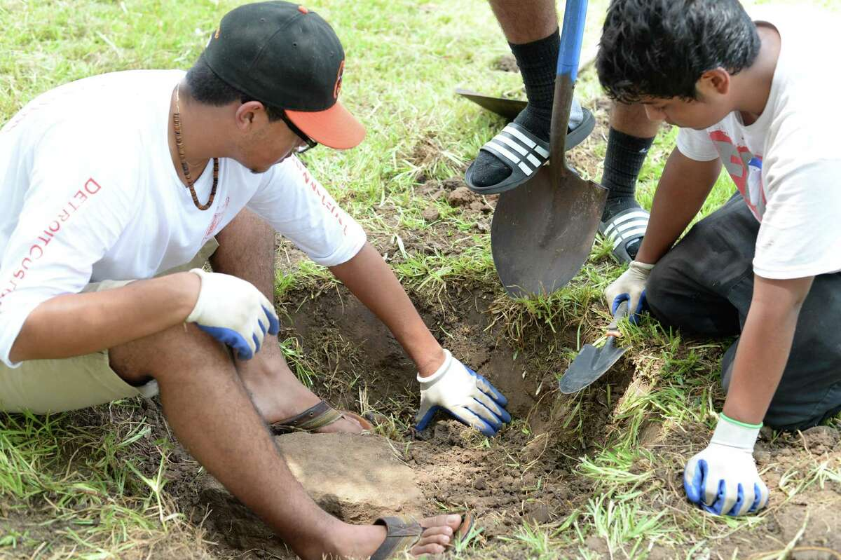 Volunteers uncovered several buried grave stones during a cleanup project at Crown Hill Cemetery in 2016.