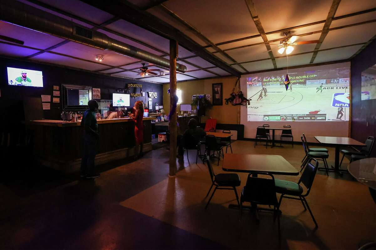 The bar at Honey's Place features sports on a large projection screen though most patrons apparently tend to stay in the outdoor covered patio due to COVID-19 concerns on the deep East Side at 7119 Joe Louis Drive on Saturday, Sept. 19, 2020.
