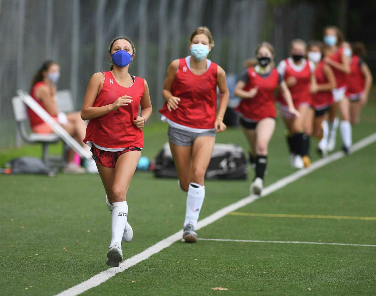 Greenwich field hockey players run laps during practice at Greenwich High School on Aug. 31.
