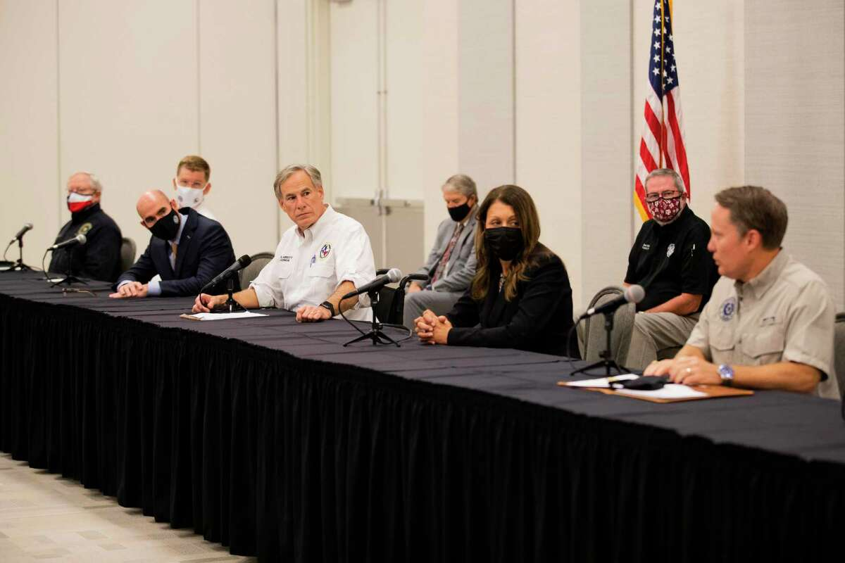 Texas Governor Greg Abbott and other state officials listen to Texas Commission on Environmental Quality executive director Toby Baker talk about steps to be taken so water is safe again for the community of Lake Jackson, Tuesday, Sept. 29, 2020.