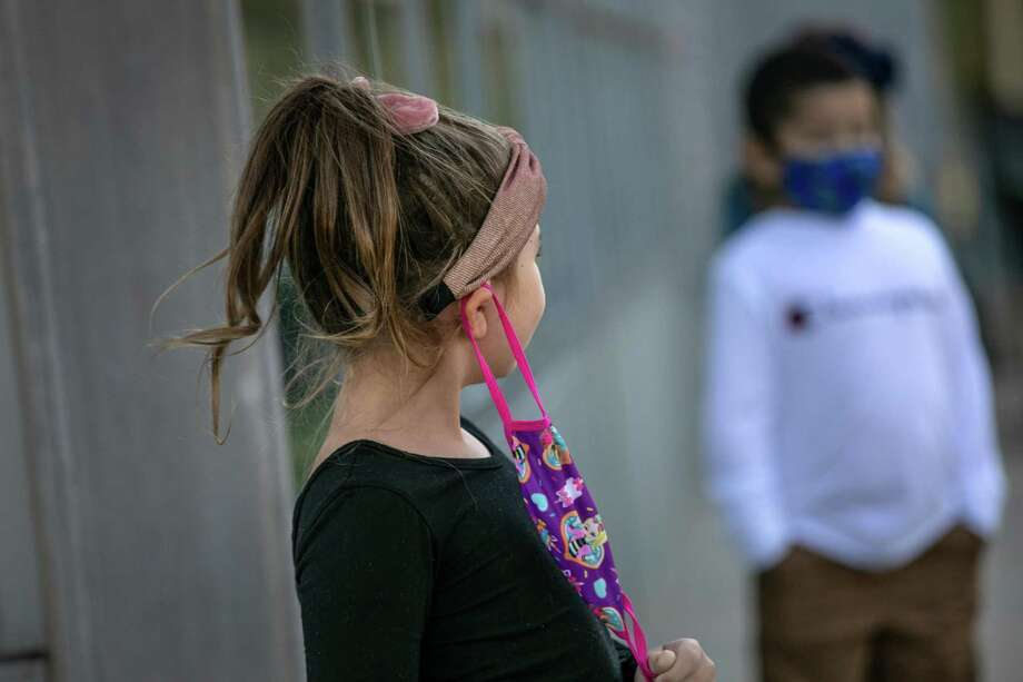 Families from five towns have filed a lawsuit to end the state's requirement for students to wear masks while in school. Photo: John Moore / Getty Images / 2020 Getty Images