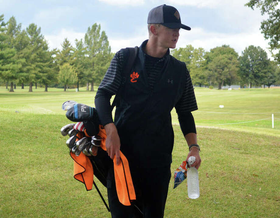 Edwardsville's Hayden Moore talks to coach Adam Tyler between on holes on Tuesday during the second day of the Southwestern Conference Tournament at Belk Park Golf Course. Photo: Scott Marion/The Intelligencer