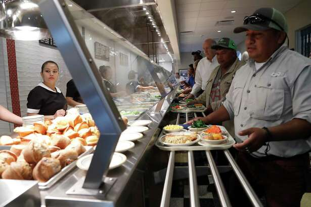 Cleburne Cafeteria with a line of people, during their soft opening on Tuesday, Nov. 14, 2017, in Houston after reopening 19 months after the building burned down in a fire. ( Karen Warren / Houston Chronicle )