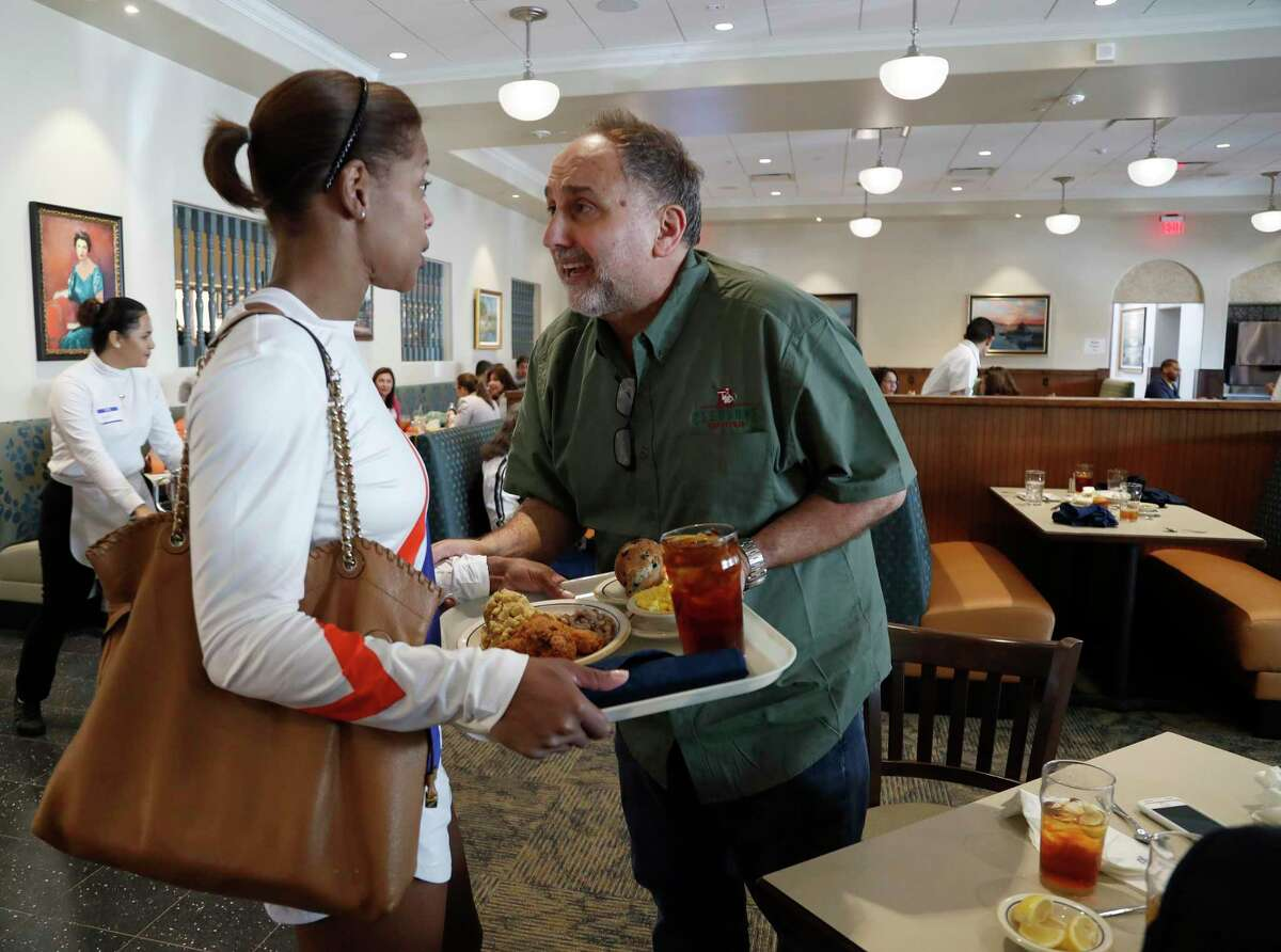Cleburne Cafeteria owner George Mickelis greets long-time customer, Tongula Steddum during their soft opening, Tuesday, Nov. 14, 2017, in Houston after reopening 19 months after the building burned down in a fire. ( Karen Warren / Houston Chronicle )