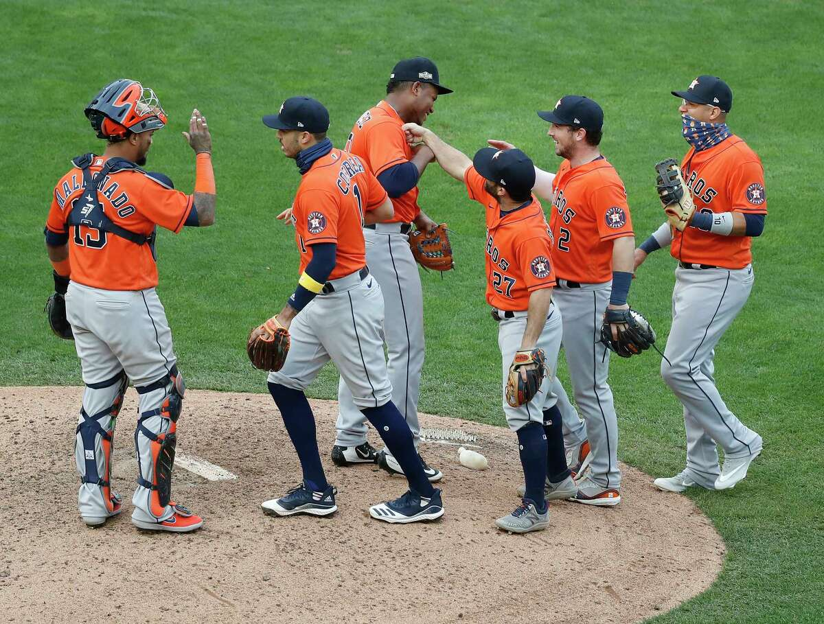 Houston Astros relief pitcher Framber Valdez (59) celebrates with catcher Martin Maldonado (15), Carlos Correa (1), Jose Altuve (27), Alex Bregman (2), and Yuli Gurriel (10) after the Astros 4-1 win over the Minnesota Twins after game one of an MLB Wild Card game at Target Field, Tuesday, September 29, 2020, in Minneapolis.