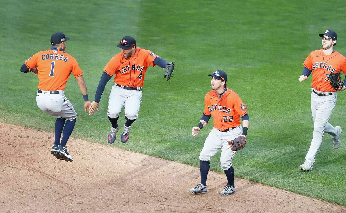 PHOTOS: More from the Astros' big Game 1 win over the Twins Houston Astros Carlos Correa (1) and George Springer (4) jump up as the celebrated with Josh Reddick after the Astros 4-1 win over the Minnesota Twins after game one of an MLB Wild Card game at Target Field, Tuesday, September 29, 2020, in Minneapolis.