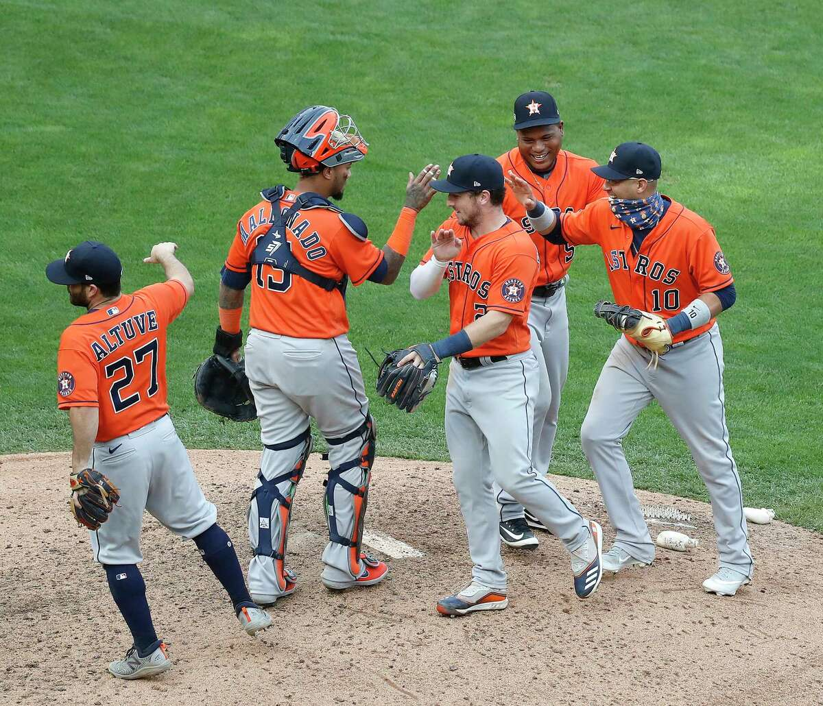 Houston Astros relief pitcher Framber Valdez (59) celebrates with catcher Martin Maldonado (15), Jose Altuve (27), Alex Bregman (2), and Yuli Gurriel (10) after the Astros 4-1 win over the Minnesota Twins after game one of an MLB Wild Card game at Target Field, Tuesday, September 29, 2020, in Minneapolis.