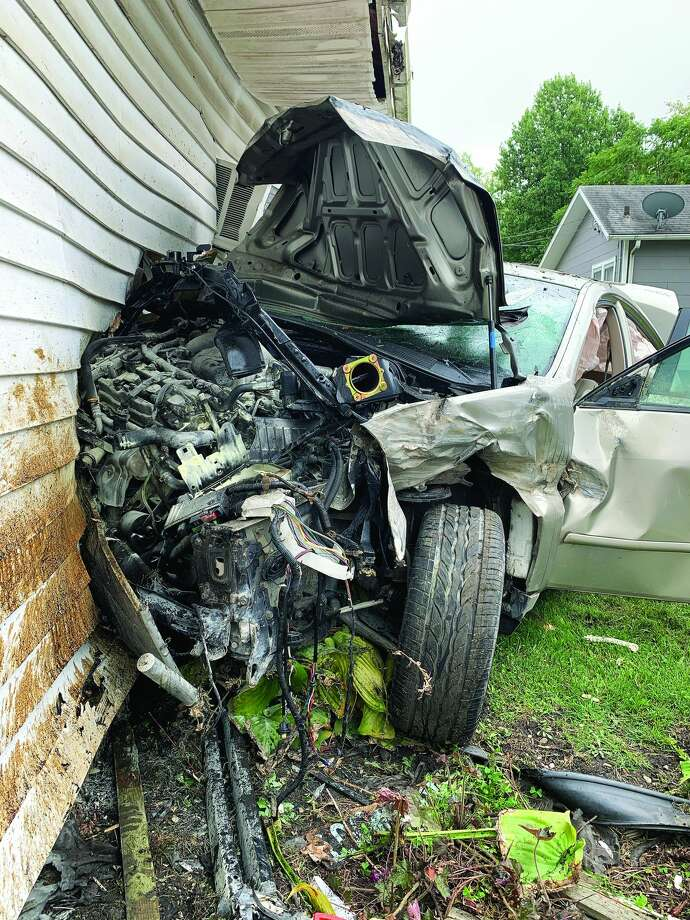 A stolen car smashed into a Jacksonville house on Monday morning after the driver lost control of the vehicle. A 14-year-old boy was arrested Tuesday in the theft. Photo: Visual Paradise Films