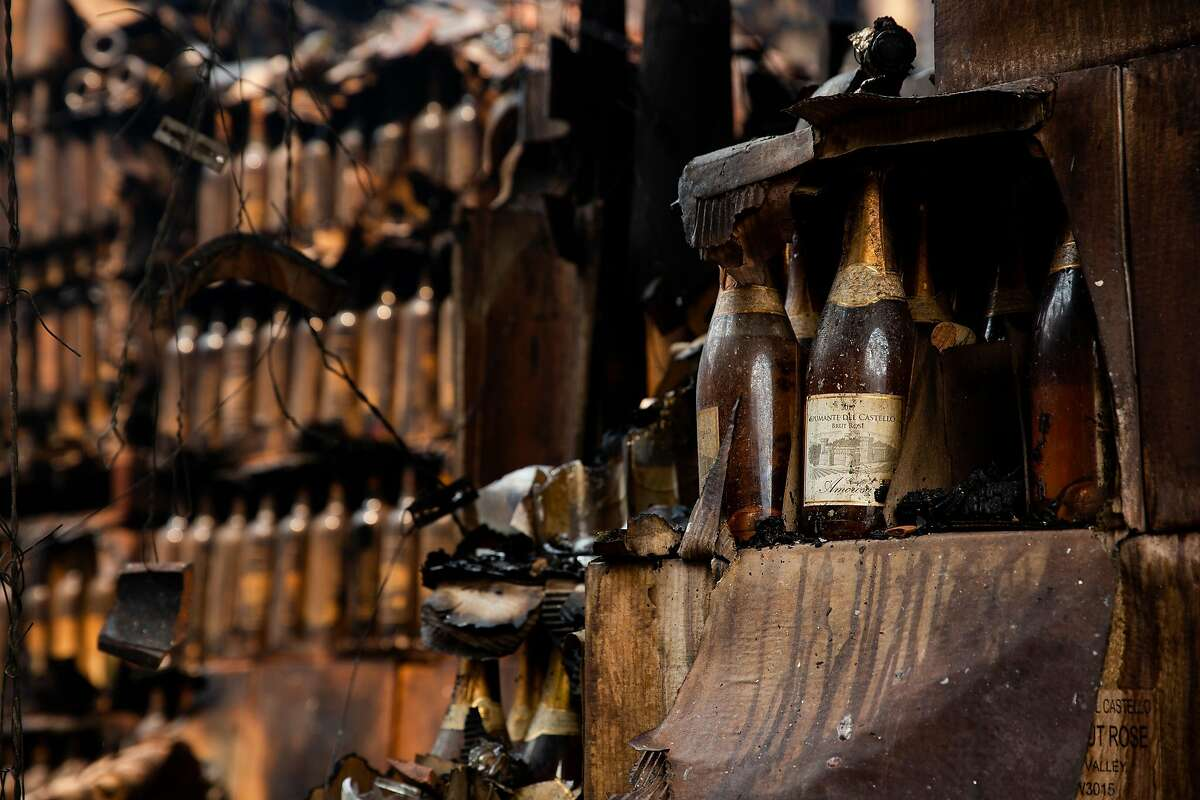 Stacks of wine bottles are left standing inside the burned out shell of the stock room at Castello di Amorosa during the Glass Fire in Calistoga, Calif. on Tuesday, Sept. 29, 2020