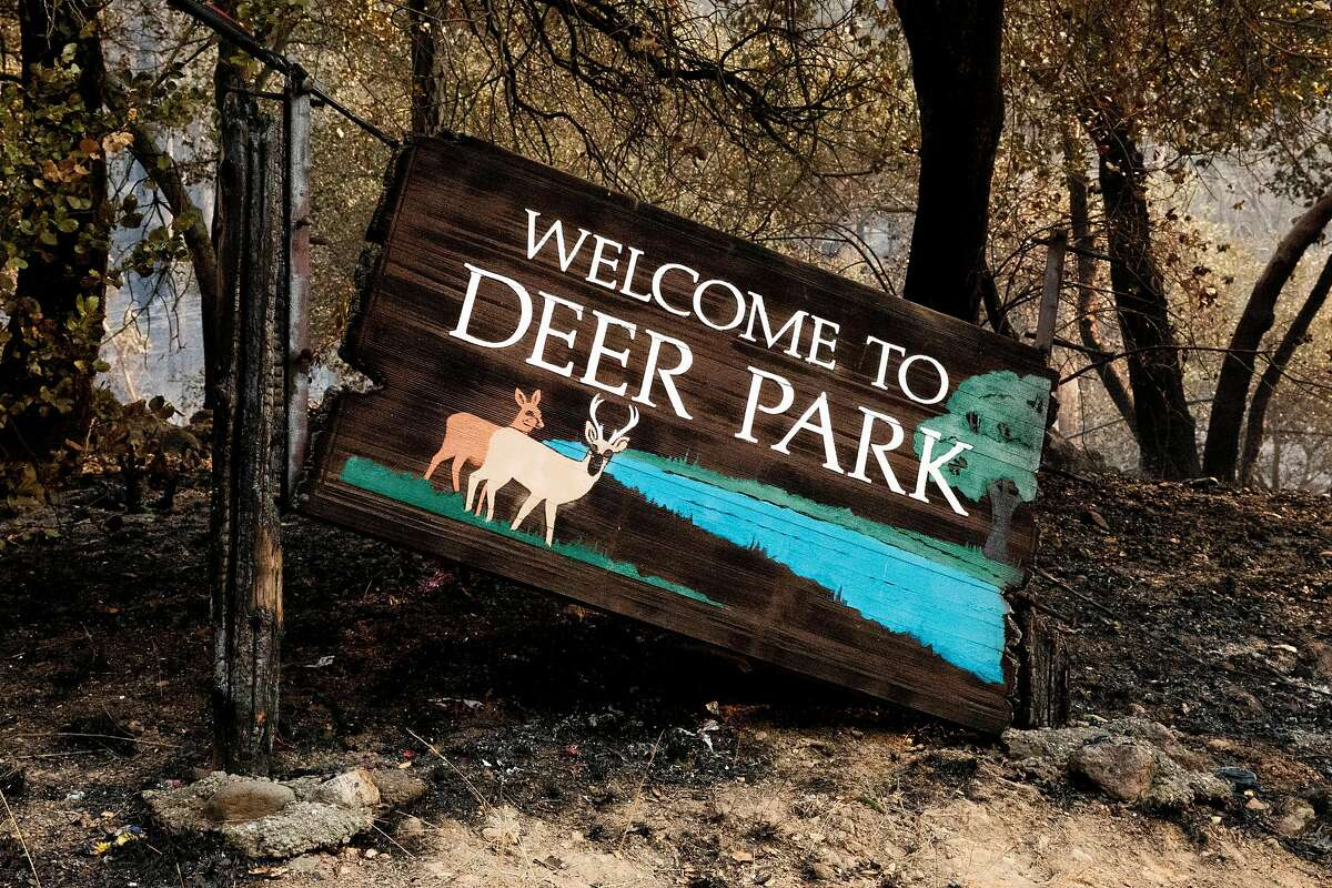 The welcome sign for Deer Park is damaged by the Glass Fire in the Deer Park area at the northern end of Napa Valley.