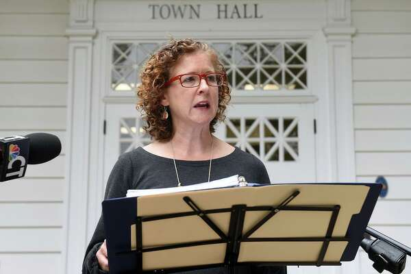 Erin Boggs, executive director of Open Communities Alliance, speaks in front of Woodbridge Town Hall on September 29, 2020, concerning the organization's challenge to the town's zoning laws restricting multi-family developments of 3 or more units.