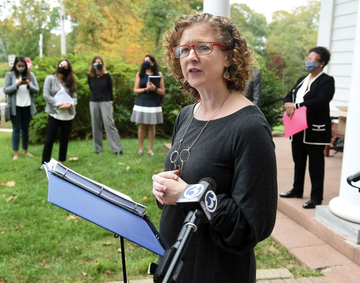 Erin Boggs, executive director of Open Communities Alliance, speaks in front of Woodbridge Town Hall on September 29, 2020 concerning the organization's challenge to the town's zoning laws restricting multi-family developments of 3 or more units.