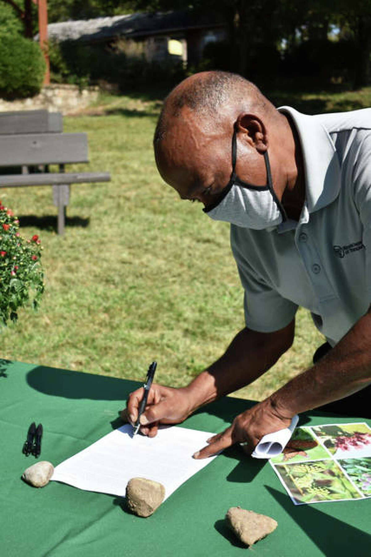 IDOT Acting Secretary Omer Osman signs the Illinois Monarch Action Plan last Thursday at Illinois State Fairgrounds' Conservation World.Tasked with bolstering the population of monarchs and other pollinators by protecting habitat and adding food sources, the project brings together public agencies, private organizations and residents of the state in a collaborative and coordinated effort to ensure the survival and successful migration of monarchs.